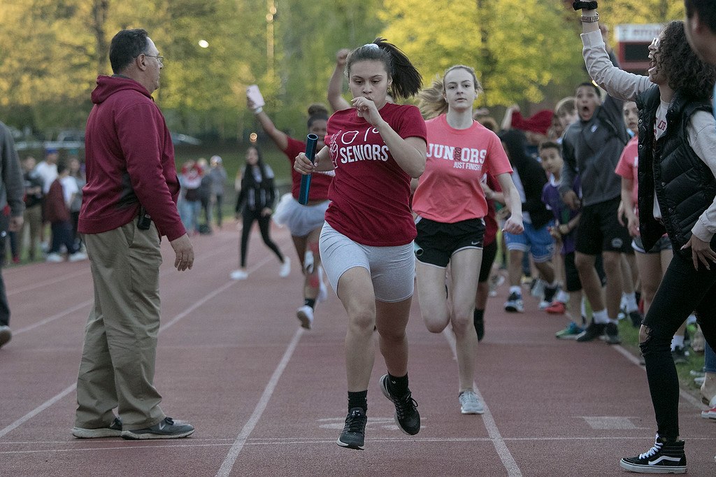 . The 105th running of the Fitchburg Schools Relays were held at Crocker Field Thursday, May 16, 2019. Athletes from Fitchburg Public Schools run against one another (school vs. school, class vs. class). Senior Jesmary Melendez crosses the finish line for the win over the junior class. SENTINEL & ENTERPRISE/JOHN LOVE
