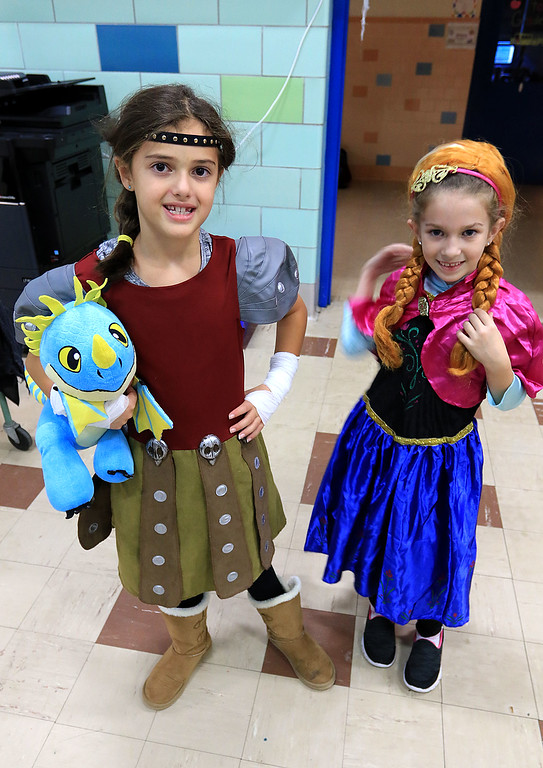 """. The Crocker PTO hosted a Halloween Dance on Friday, October 19 2018 at Crocker Elementary School in Fitchburg. Ellie Bragon, 8 on left, was dressed as Astrid from the movie \""""How to train your dragon\"""" and Isaberlla Priviter, 8, was dressed as Anna from \""""Frozen\"""" at the dance. SENTINEL & ENTERPRISE/JOHN LOVE"""
