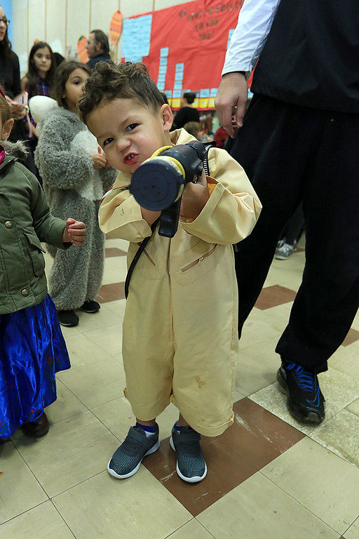 . The Crocker PTO hosted a Halloween Dance on Friday, October 19 2018 at Crocker Elementary School in Fitchburg. Bobby Divola, 2, came to the dance dressed as a Ghostbuster in a homemade costume. SENTINEL & ENTERPRISE/JOHN LOVE