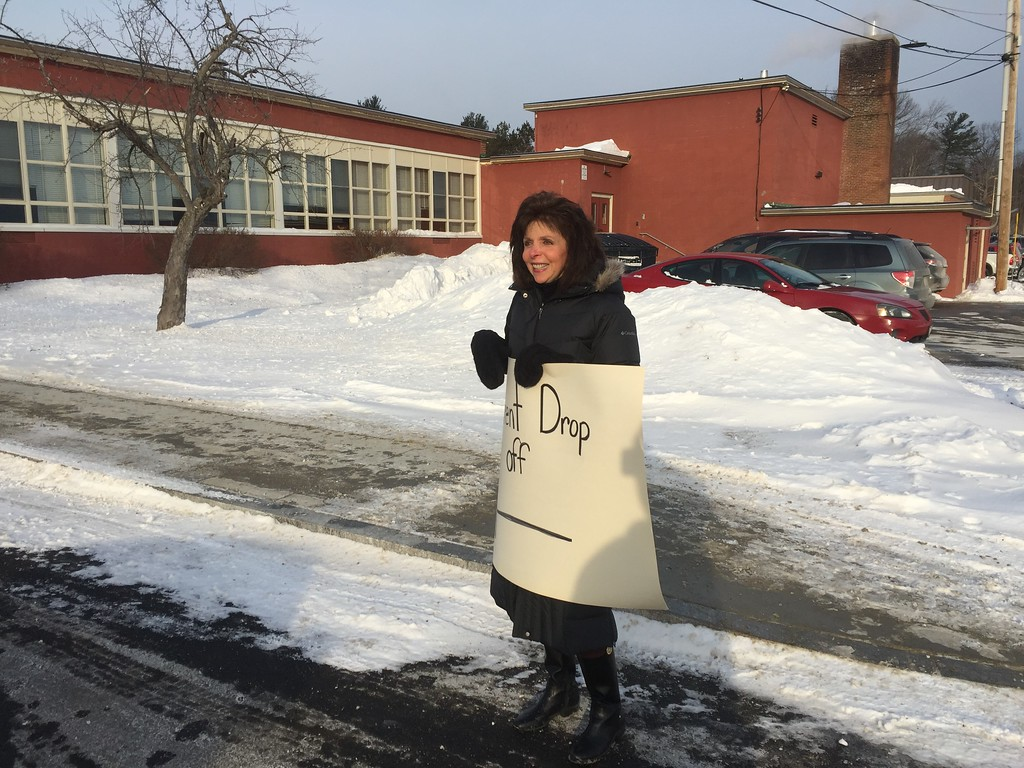 . Debra Jeffries, a Title 1 teacher at Crocker Elementary School, welcomes students and parents to T.C. Passios in Lunenburg.   Students from Crocker Elementary School in Fitchburg started school Monday, 1/9/18, at the former TC Passios School in Lunenburg. 650 students from Crocker had to find temporary housing after winter break when a broken steam pipe damaged several classrooms and ceiling tiles containing asbestos. CONTRIBUTED PHOTO/CHAD GARDNER, FITCHBURG PUBLIC SCHOOLS