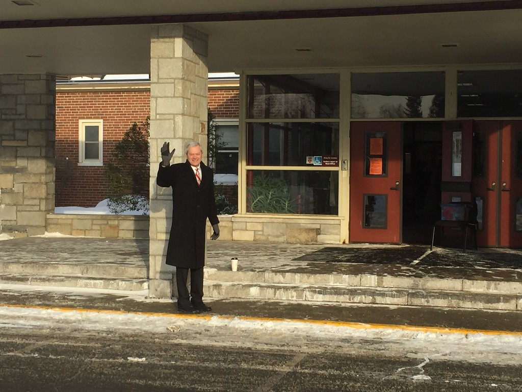 . Fitchburg Supt. Andre Ravenelle greets the buses.. Students from Crocker Elementary School in Fitchburg started school Monday, 1/9/18, at the former TC Passios School in Lunenburg. 650 students from Crocker had to find temporary housing after winter break when a broken steam pipe damaged several classrooms and ceiling tiles containing asbestos. CONTRIBUTED PHOTO/CHAD GARDNER, FITCHBURG PUBLIC SCHOOLS
