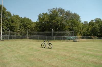 For the purpose of this tour, the left end of the start line is even with the third support hoop of the batting cage.