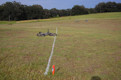 "Looking down the starting line from the right end to the left. (Racers would run to my right, in this view.) The finish line is straight ahead on the edge of the ""rough."" Look in the distance just above the bike's handlebar tip."