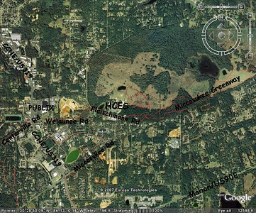 Area map showing HCES and the course. Holy Comforter is at 2001 Fleischmann Rd. It's easily accessible from Capital Circle NE via Centerville Rd, the new luxurious 4 lane Welaunee Rd, and Miccosukee Rd. Note how it backs up to Miccosukee Greenway.