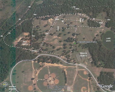 (Old map from 2006.) LINCOLN XC COURSE NORTH is to the LEFT. Aerial view from Google Earth. If you look carefully, you might notice I've used different shapes for the dots designating the Start to 1M, 1M to 2M, 2M to 3M, and 3M to the 5k finish. I DO NOT recommend using spikes on this course! Too much asphalt. Spectators traditionally head into the woods after the kids head up the road after 800m. There's a great view of the racers as they pass the halfway point at 2.5k. Then, back out of the woods to the 2M and then the finish by the big pavilion.
