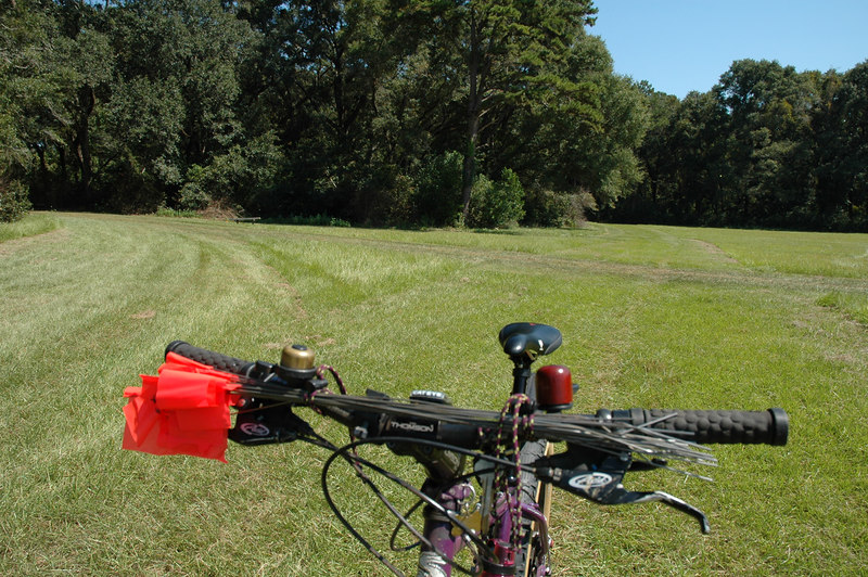 """3600m<br /> Same as the previous shot, but looking back. You can see how we've closed the east """"loop."""" Highside to the left, lowside (where we just came from) directly behind the Pugsley.<br /> Is that a wooden bell on the handlebar? What is this, Switzerland?"""