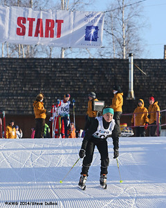 A female racer at the starting line of the freestyle xc race.