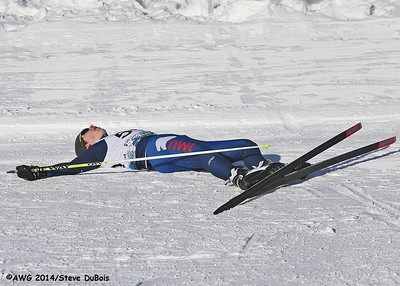 A race lies exhausted at the finish line in the boys xc freestyle on 3/17.