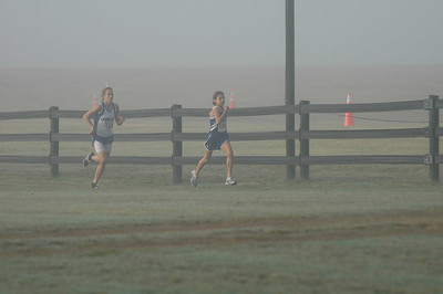 3:56 Ashley Brasovan leads Emilie Amaro on the back straightaway.