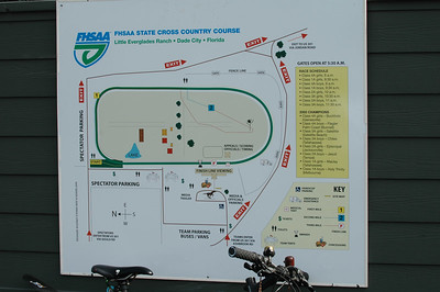 Guess the first thing I'll post is the last photo I took. It's a course map from behind the main steeplechase grandstands at Little Everglades Ranch.  Yes, I did get a chance to roll the scrupulously calibrated P-Snoop the Pugsley fatbike over the course on Friday afternoon. I got 5010m. Stayed 2m or less from the rail, and center of tread on the infield. (Incidentally, I measured the perimeter - thus defined - to be ~1870m.) Saturday morning, I noticed they marked the start line up just a few meters from where I'd been told it was going to be. Call it 5000m, ok? Nice job, guys! We'll have to complain about something other than course length for 2006.