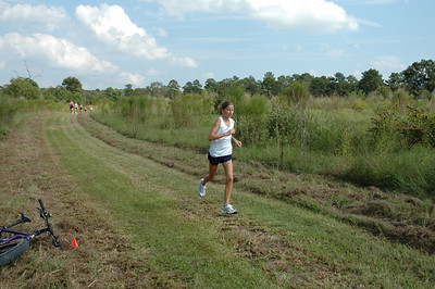 3:34 Brooke passes the 800m pinflag. Isn't this course tread nicely done for a cross country race?