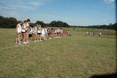 L.A. fires the gun to begin the Girls' 1.5M XC race.