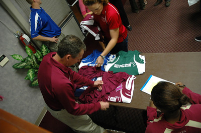 FSU Head T&F/XC Coach Bob Braman assists with distribution of the slick team jerseys. Assistant Coach Althea Belgrave makes sure Coach Bob gets it right. Without Coach Braman, it's doubtful this event would have continued all these years. We love ya, Bob!