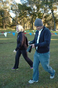 FACA Cross Country Chairman Kristin McWilliams and Flrunners photographer Jeff Adams head to the Girls' 5k start.