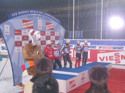 Andy Newell (second from right) prepares to step onto the podium in the classic sprint to open the 2007 FIS Nordic World Ski Championships in Sapporo (credit: Doug Haney/U.S. Ski Team)