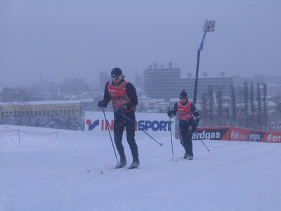 Andy Newell and Laura Valaas testing skis during training on Feb. 21 at the Sapporo Dome (credit: Doug Haney/U.S. Ski Team)