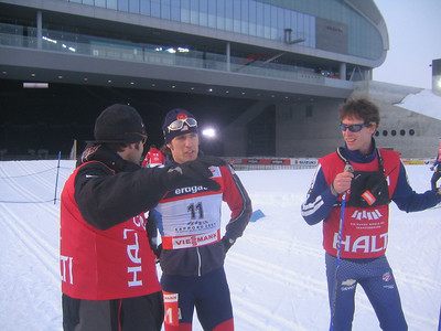 Torin Koos (center) talks strategy with coaches Justin Wadsworth (left) and Pat Casey (credit: Doug Haney/U.S. Ski Team)