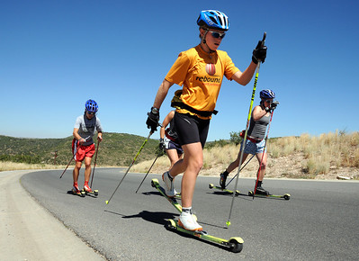 U.S. Cross Country Ski Team skiers Liz Stephen (foreground), Morgan Arritola (left), Lindsay Williams (right) and Lindsey Dehlin (hidden) roller ski on a training course around Park Meadows in Park City, Utah, the home of the U.S. Ski Team. (c) 2008 USSA/Tom Kelly
