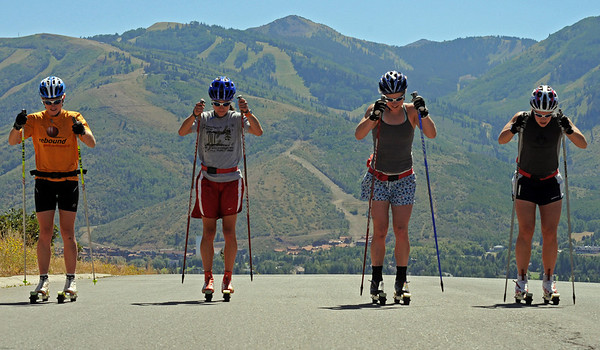 U.S. Cross Country Ski Team skiers (from left) Liz Stephen, Morgan Arritola, Lindsay Williams and Lindsey Dehlin roller ski on a training course around Park Meadows in Park City, Utah, the home of the U.S. Ski Team with Park City Mountain Resort in the background. (c) 2008 USSA/Tom Kelly
