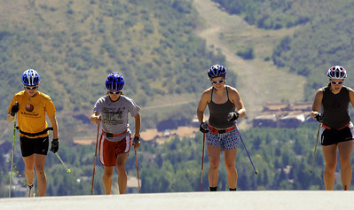 U.S. Cross Country Ski Team skiers (from left) Liz Stephen, Morgan Arritola, Lindsay Williams and Lindsey Dehlin roller ski on a training course around Park Meadows in Park City, Utah, the home of the U.S. Ski Team. (c) 2008 USSA/Tom Kelly