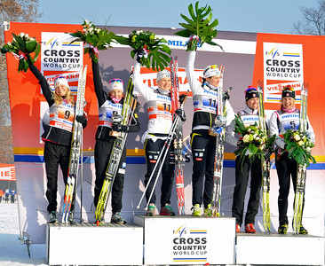 Jessie Diggins and Kikkan Randall during the awards ceremony for their 2nd place in team sprint.   2012 FIS Cross Country World Cup in Milan, Italy. Photo © Matt Whitcomb/U.S. Ski Team
