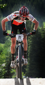 U.S. Cross Country Ski Team athlete Tad Elliott charges over a jump at the USA Cycling National Mountain Bike Championships in Sun Valley, Idaho. (c) 2011 Tom Kelly