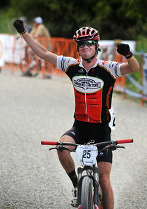 U.S. Cross Country Ski Team member Tad Elliott (Durango, CO) raises his fists after a stellar top 10 finish in the USA Cycling Mountain Bike Championships cross country event in Sun Valley, Idaho. (c) 2011 Tom Kelly