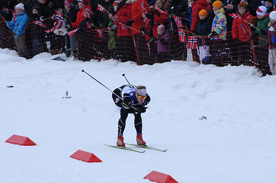 Kris Freeman tucks down a hill in front of thousands of fans during the men's 30k pursuit race at the 2011 FIS Nordic World Ski Championships at Holmenkollen in Oslo, Norway. (c) 2011 U.S. Ski Team