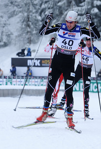 Lars Flora charges with teammate Tad Elliot in the background during the men's 30k pursuit race at the 2011 FIS Nordic World Ski Championships at Holmenkollen in Oslo, Norway. (c) 2011 U.S. Ski Team
