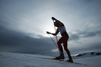 A skier is silhouetted as he nears the top of a climb as top cross country skiers tackle the challenging Dollar Mountain Hillclimb to wrapup the SuperTour Finals in Sun Valley, ID. (c) 2011 USSA