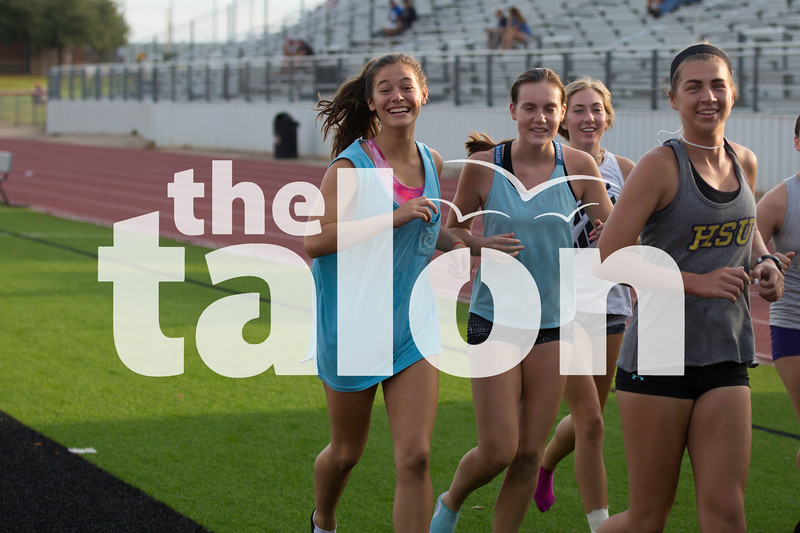 The Eagles cross country team practices during 2-A-Days on the Argyle high School Track in Argyle, Texas, on August 9, 2018. (Andrew Fritz / The Talon News)