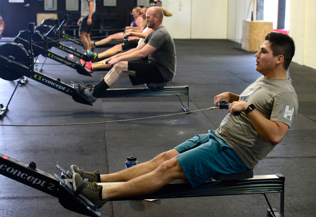 . Emmett Elizondo, works on the rowing machine during class at CrossFit Lefthand in Boulder on Tuesday. For more photos go to dailycamera.com. Paul Aiken / Staff Photographer July 3, 2018