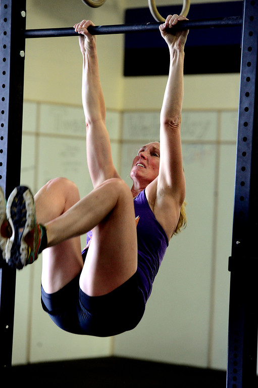 . Mary Rios performs a toes to bar set during class at CrossFit Lefthand in Boulder on Tuesday. For more photos go to dailycamera.com. Paul Aiken / Staff Photographer July 3, 2018