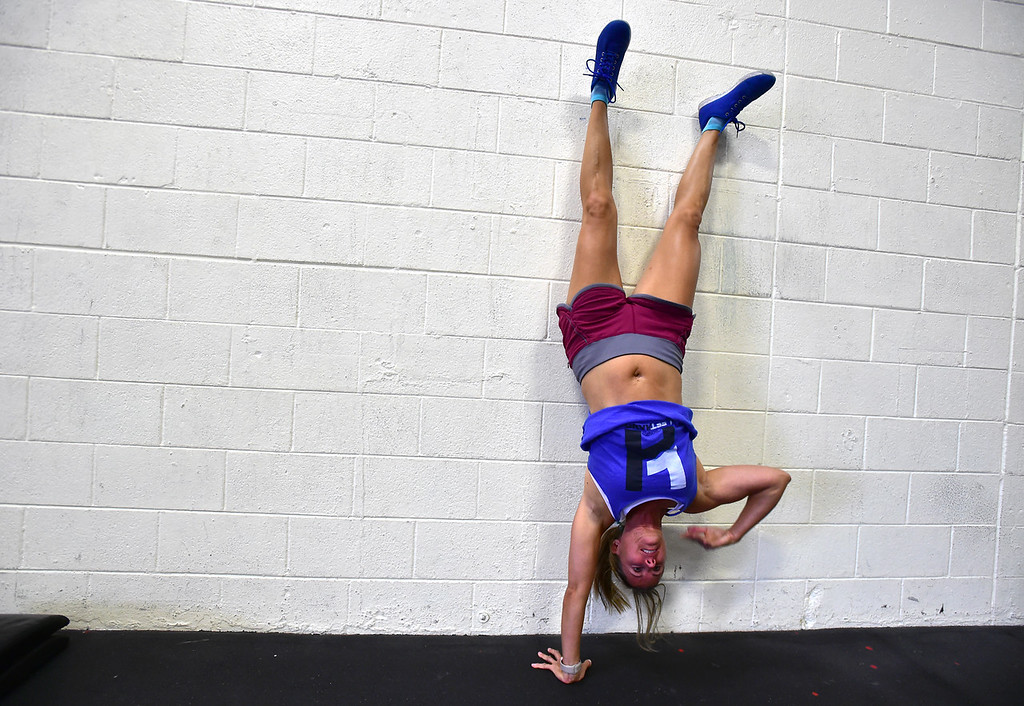. Megan Saad does walking handstands during class at CrossFit Lefthand in Boulder on Tuesday. For more photos go to dailycamera.com. Paul Aiken / Staff Photographer July 3, 2018