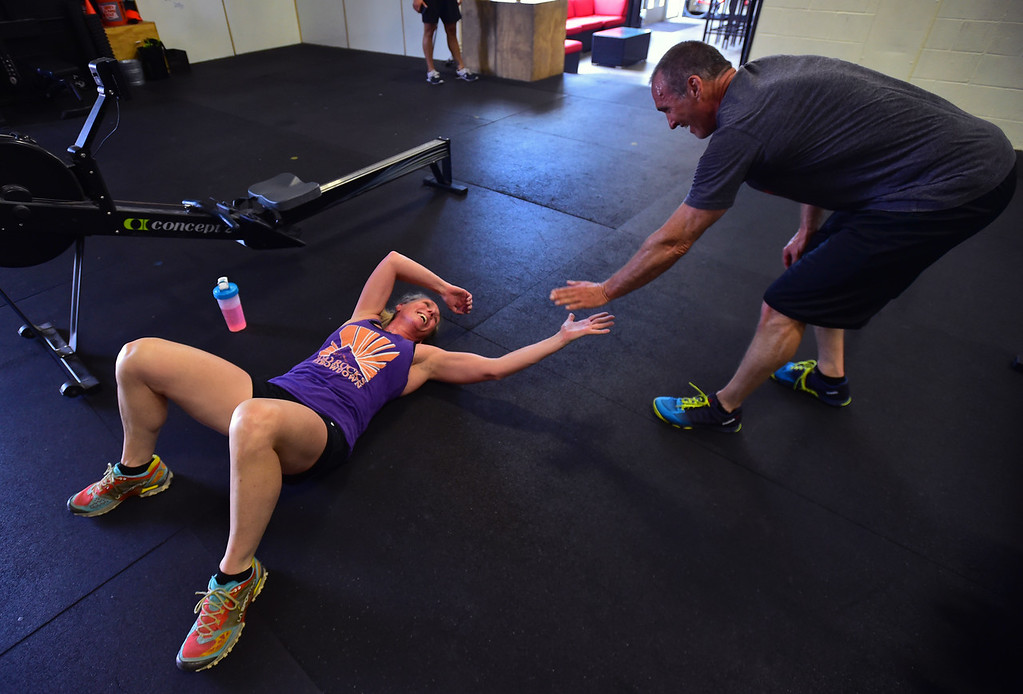 . Mary Rios gets congratulated by fellow student Todd Roadman during class at CrossFit Lefthand in Boulder on Tuesday. For more photos go to dailycamera.com. Paul Aiken / Staff Photographer July 3, 2018