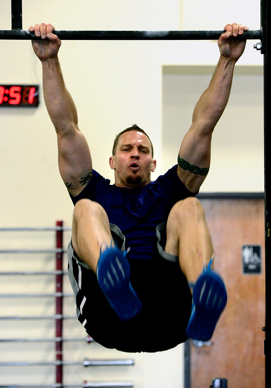 . James Montague performs toes to bar during class at CrossFit Lefthand in Boulder on Tuesday. For more photos go to dailycamera.com. Paul Aiken / Staff Photographer July 3, 2018