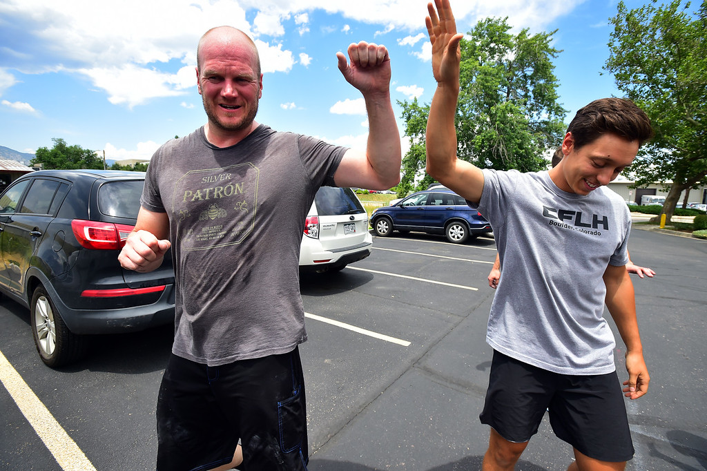 . Greg Doyle, left, gets a high five from instructor Patrick Rios after a tough class at CrossFit Lefthand in Boulder on Tuesday. For more photos go to dailycamera.com. Paul Aiken / Staff Photographer July 3, 2018