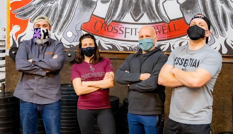 CrossFit coaches include, from left, Sean Osborne of Chelmsford, Christina Nikitopoulos and owner Trent Pepicelli, both of Lowell, and Dan Leverone of Tewksbury. Missing from photo are Tiffany Foster of Lowell and Jason Morang of Manchester, N.H.