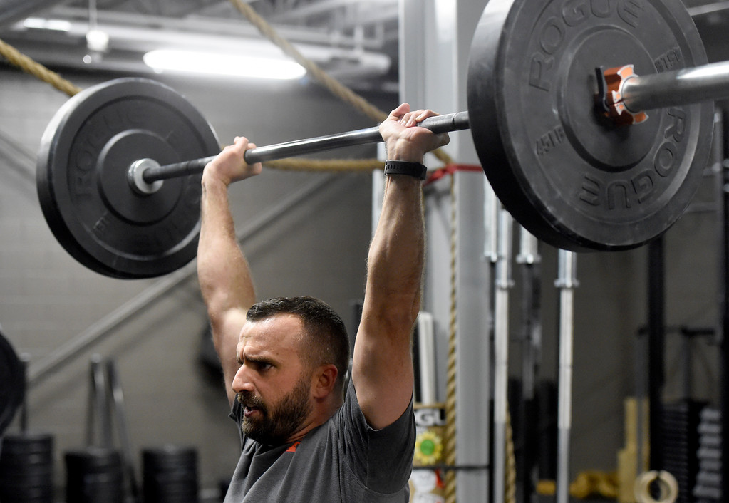 . John Schminky uses weights during a Crossfit workout class at Impact Sports Performance on Thursday inside the Sports Stable in Superior. For more photos of the class go to dailycamera.com Jeremy Papasso/ Staff Photographer 12/28/2017