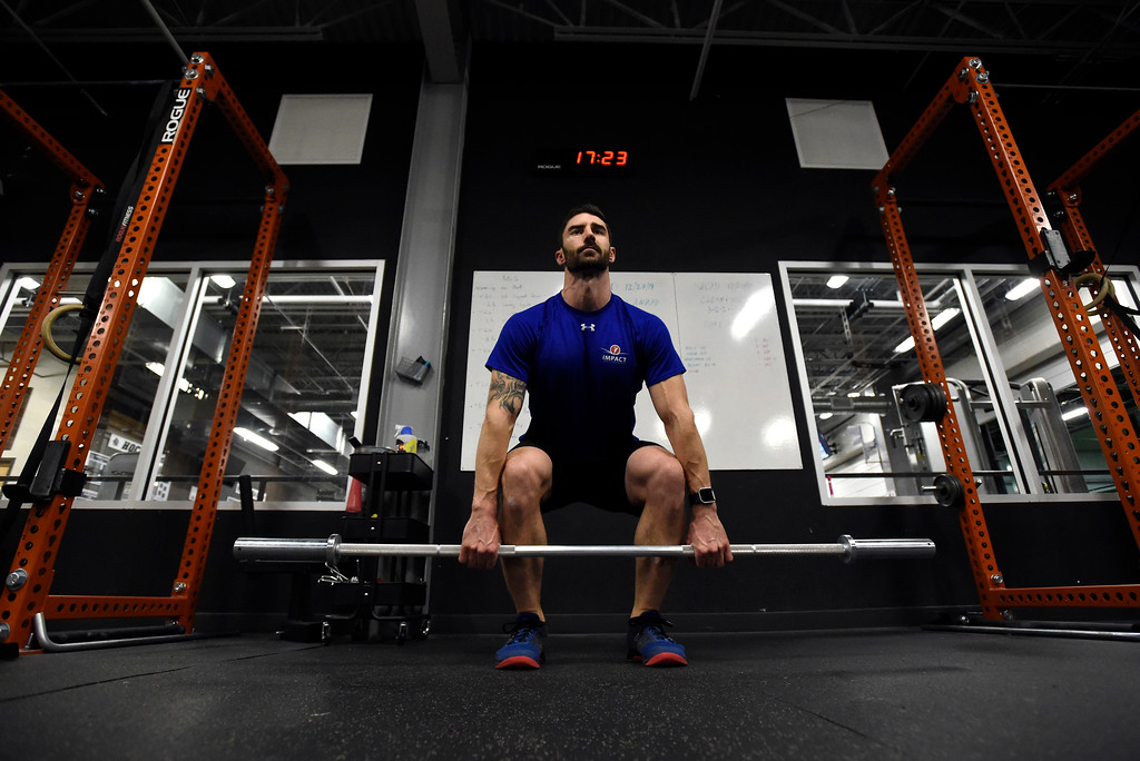 . Instructor Nick Gilbreath demonstrates an exercise to his students during a Crossfit workout class at Impact Sports Performance on Thursday inside the Sports Stable in Superior. For more photos of the class go to dailycamera.com Jeremy Papasso/ Staff Photographer 12/28/2017