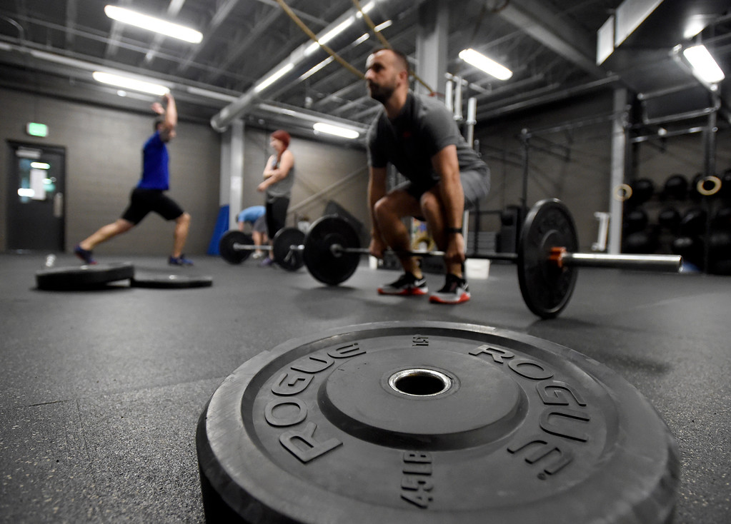 . People exercise during a Crossfit workout class at Impact Sports Performance on Thursday inside the Sports Stable in Superior. For more photos of the class go to dailycamera.com Jeremy Papasso/ Staff Photographer 12/28/2017