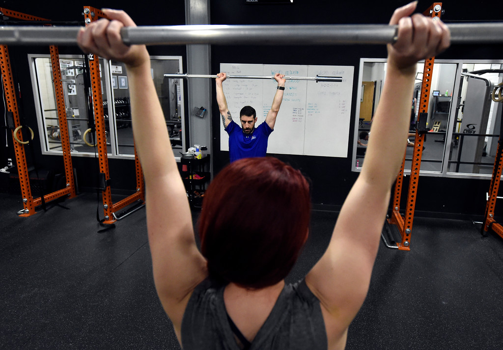 . Instructor Nick Gilbreath, at center, demonstrates an exercise during a Crossfit workout class at Impact Sports Performance on Thursday inside the Sports Stable in Superior. For more photos of the class go to dailycamera.com Jeremy Papasso/ Staff Photographer 12/28/2017