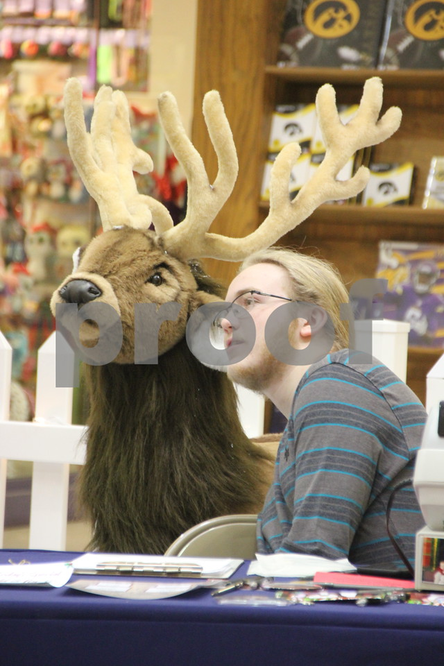 Saturday, December 12, 2015 found shoppers at Crossroads Mall in Fort Dodge shopping for Christmas gifts. Only two weeks and six days left before Christmas. Jay Bohn is pictured here with one of Santa's reindeer,  helping  with pictures with Santa at  Crossroads Mall.