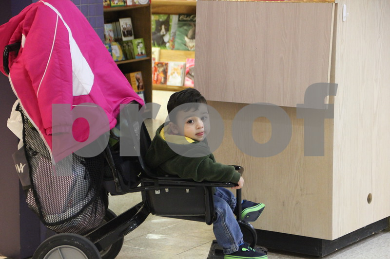 Saturday, December 12, 2015 found  shoppers at Crossroads Mall in Fort Dodge shopping for Christmas gifts. This little guy was chilling out while his mom was shopping. Pictured is: Luis Dilan Cruz.