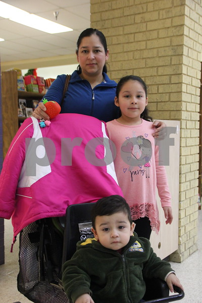 Saturday, December 12, 2015 found shoppers at Crossroads Mall in Fort Dodge shopping for Christmas gifts. Pictured is: (back) Lupta Soto, (middle) Irlanda Cruz, and  (front) Luis Dilan Cruz.