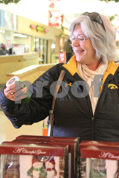 Shown here is: Patti Schoon checking out some deals at the Crossroads Mall on Monday, December 12, 2016, while shopping before Christmas arrives.