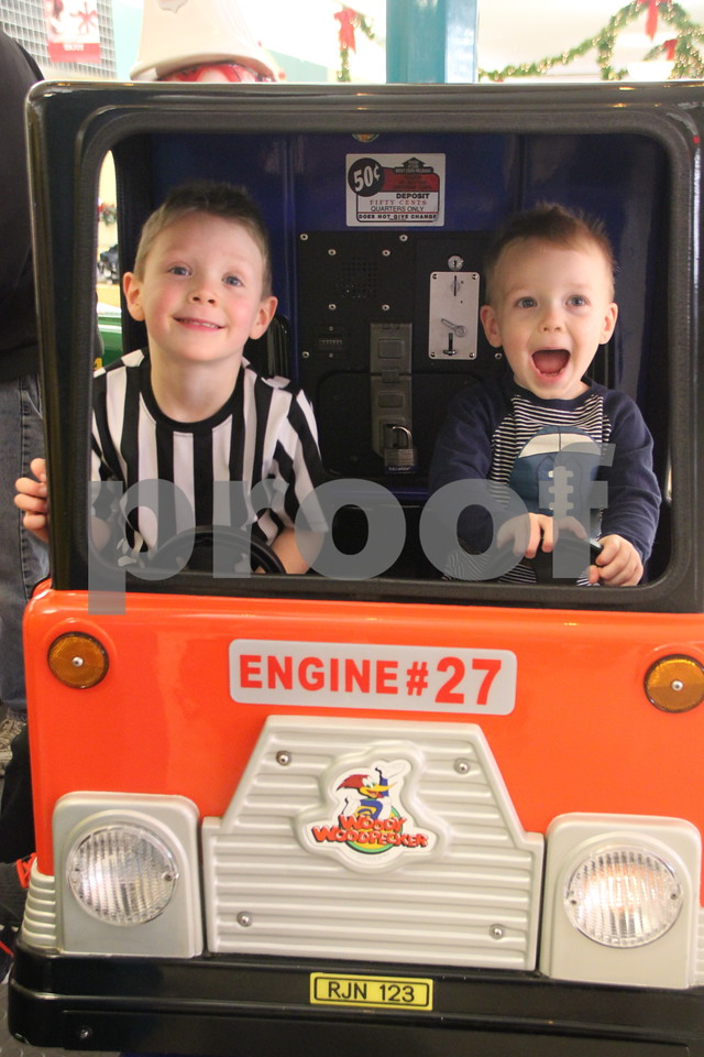 Seen  left to right is: Garrett and Cole Schuknecht having fun at the Crossroads Mall on  Monday, December 12, 2016,  while shopping with their mom before Christmas arrives.