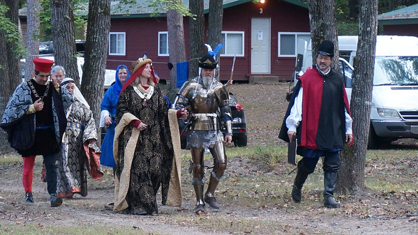 King Brian & Queen Lorelei walk to court.