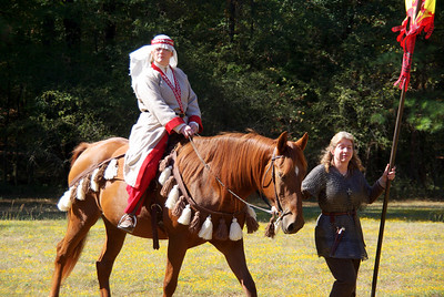 Bri arrives on horseback