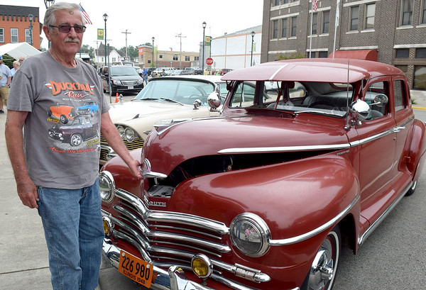 Richard Doehring of Stewardson pops the hood of his 1948 Plymoth Special Deluxe during Cruise Night in downtown Effingham. Dawn Schabbing photo